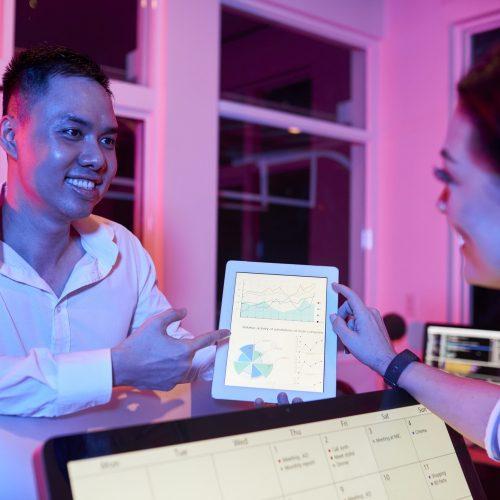 Smiling Entrepreneurs Discussing Diagram